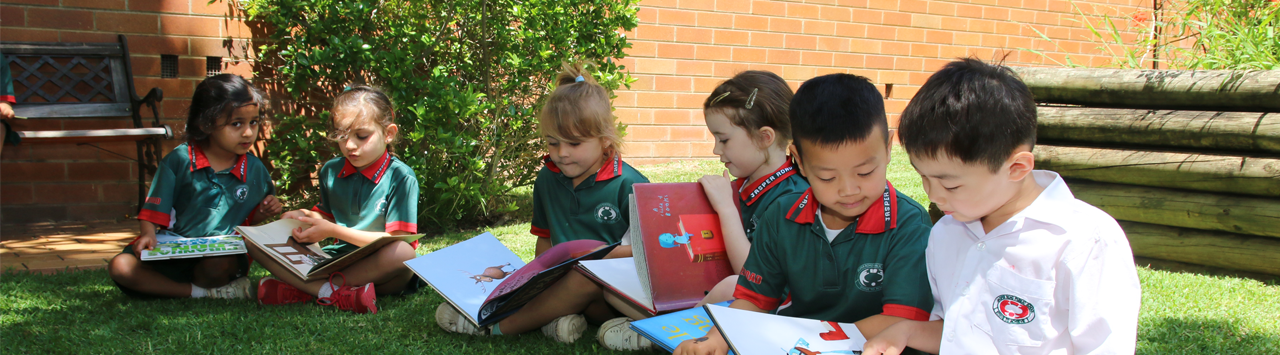 Students enjoying reading in the garden area